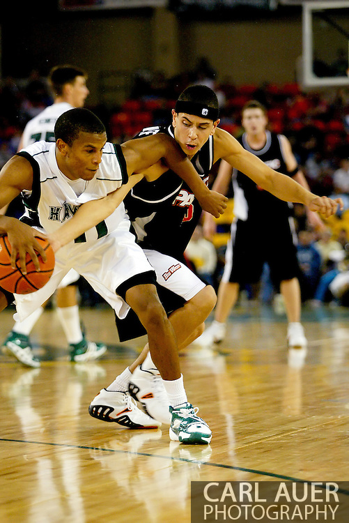 11/25/2006 - Anchorage, Alaska: Sophomore guard Dominic Waters (11) of the Hawaii Warriors tries to keep Solomon Horsechief (10) of Pacific away from the ball as Hawaii beat Pacific 71-60 to give the Warriors a third place finish in the 2006 Great Alaska Shootout<br />