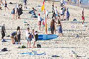 Sydney, Australia. Tuesday 21 April 2020. Coogee beach in Sydney's eastern suburbs reopened after the lockdown restrictions. Locals are allowed to swim, surf and exercise but must not sunbathe, sit on the sand or gather in groups due to COVID-19 pandemic. Credit Paul Lovelace/Alamy Live News.
