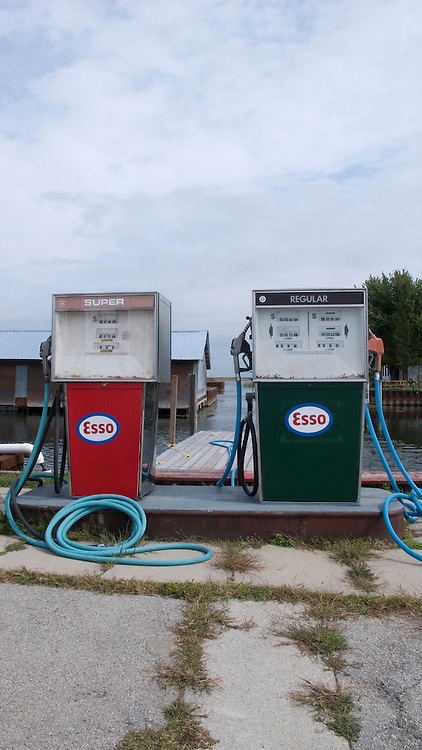Gas pumps on jetty on Lake Eirie, Canada