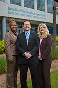 Houston ISD print services leaders Reba Jelks, left, Charles Werninger, Jr., center, and Deborah Roberts, pose for a photograph March 26, 2015.