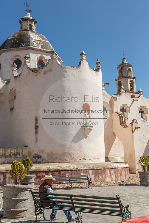 A Mexican pilgrim rests outside the fortress like Mexican baroque Sanctuary of Atotonilco and Santa Escuela de Cristo, an important Catholic shrine in Atotonilco, Mexico.