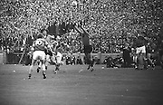 Kerry forward passes over the head of Down Back during the All Ireland Senior Gaelic Football Final Kerry v Down in Croke Park on the 22nd September 1968. Down 2-12 Kerry 1-13.