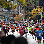 Runners make their way along First Avenue in Manhattan, New York, during the ING New York Marathon. New York, USA. 3rd November 2013. Photo Tim Clayton