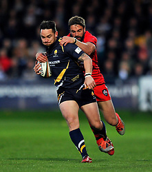 Ryan Lamb of Worcester Warriors is tackled by Nicky Robinson of Bristol Rugby - Photo mandatory by-line: Patrick Khachfe/JMP - Mobile: 07966 386802 27/05/2015 - SPORT - RUGBY UNION - Worcester - Sixways Stadium - Worcester Warriors v Bristol Rugby - Greene King IPA Championship Play-off Final (Second leg)