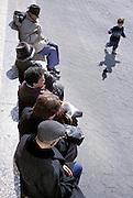 Elderly people watching a child