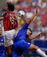 Chelsea's Hernan Crespo and AC Milan's Alessandro Nesta battle during a match.   (Photo by Robert Falcetti). .
