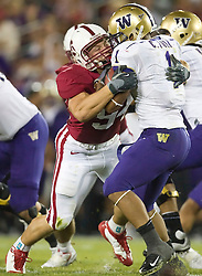 September 26, 2009; Stanford, CA, USA; Stanford Cardinal defensive end Tom Keiser (94) tackles Washington Huskies running back Chris Polk (1) in the backfield for a loss in the second quarter at Stanford Stadium.