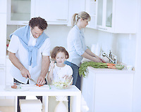Family preparing healthy meal in kitchen