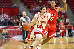 11 November 2007: Alex Rubin goes strong around Jason Black. Illinois State Redbirds defeated the Missouri - St. Louis Tritons 70-37 in an early season game on Doug Collins Court in Redbird Arena on the campus of Illinois State University in Normal Illinois.