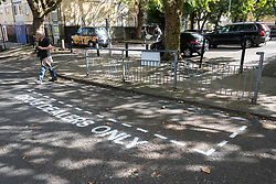"""© Licensed to London News Pictures. 16/09/2018. London, UK. Community activists spray paint """"Drug Dealer Only"""" parking spaces and erect street signs to highlight increasing levels of drug dealing in the E2 postcode, known as the cheapest heroin in Europe, East London, UK. Photo credit: Ray Tang/LNP"""
