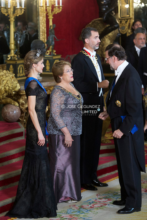King Felipe VI of Spain, Michelle Bachelet, Queen Letizia of Spain and Mariano Rajoy attended a Gala Dinner in honour of Chilean President during her State Visit at Palacio Real on October 29, 2014 in Madrid