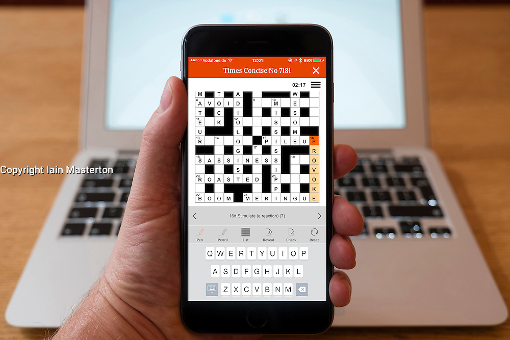 Detail of The Time crossword puzzle being solved on a smart phone