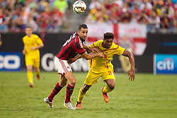 CHARLOTTE, USA - Saturday, August 2, 2014: Liverpool's Jordon Ibe in action against AC Milan's Adil Rami during the International Champions Cup Group B match at the Bank of America Stadium on day thirteen of the club's USA Tour. (Pic by Mark Davison/Propaganda)