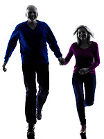 one caucasian couple senior  running happy silhouette  in silhouette studio isolated on white background