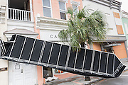 An awning hangs from a shop along King Street in historic downtown after Hurricane Matthew passed through causing flooding and light damage to the area October 8, 2016 in Charleston, South Carolina. The hurricane made landfall near Charleston as a Category 2 storm but quickly diminished as it moved north.
