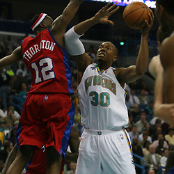 15 April 2008: New Orleans Hornets forward David West #30 makes a move to the basket as Al Thornton#12 defends for the Los Angeles Clippers  in the first quarter of the Hornets 114-92 win over the Clippers at the New Orleans Arena in New Orleans, Louisiana.