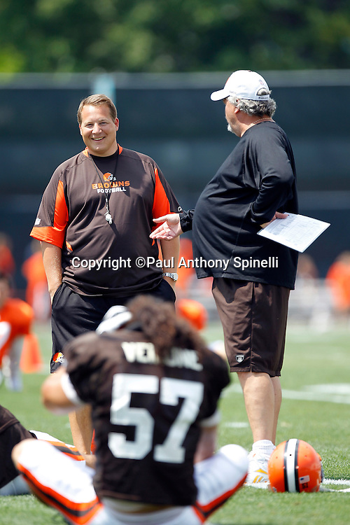 Cleveland Browns Head Coach Eric Mangini and Defensive Coordinator Rob Ryan share a laugh as they chat with a player during NFL football training camp at the Cleveland Browns Training Complex on Monday, August 9, 2010 in Berea, Ohio. (©Paul Anthony Spinelli)
