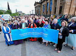 Pictured: Women ministers and supporters march up the Mound to the General Assembly, led by former Moderator the Reverend Lorna Hood.<br /> <br /> Women ministers and supporters processed up the Mound in Edinburgh to the General Assembly of the Church of Scotland to mark 50 years since the Church allowed the ordination of women.<br /> <br /> &copy; Dave Johnston / EEm