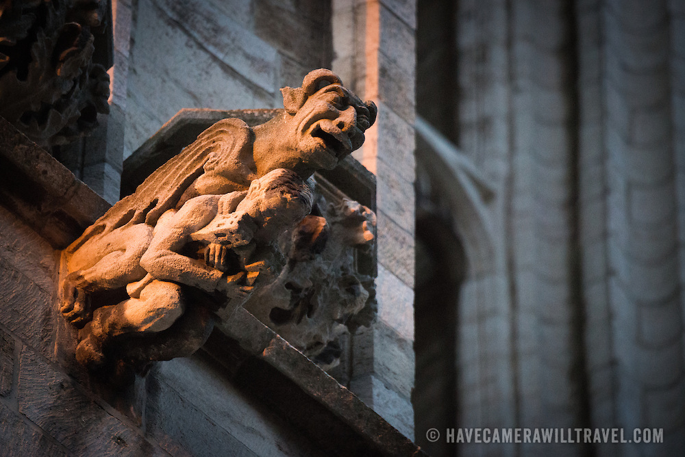 A gargoyle on the exterior of the Cathedral of St. Michael and St. Gudula. Standing prominently on a hill in central Brussels, the current cathedral dates back to the 13th century, although a church has been on this site at least since the 11th century. It is the national cathedral of Belgium and site of royal coronations and weddings.