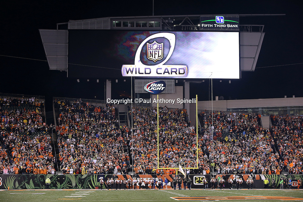 The NFL Wild Card logo is shown on the Paul Brown Stadium scoreboard in this general view, wide angle photograph of the stadium interior taken during pregame player introductions before the Cincinnati Bengals NFL AFC Wild Card playoff football game against the Pittsburgh Steelers on Saturday, Jan. 9, 2016 in Cincinnati. The Steelers won the game 18-16. (©Paul Anthony Spinelli)