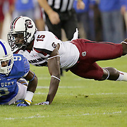 September 29, 2012 - Lexington, Kentucky, USA - UK's Demarco Robinson is brought down by South Carolina's Jimmy Legree in the first half as the University of Kentucky plays South Carolina at Commonwealth Stadium. South Carolina won the game 38-17. (Credit Image: © David Stephenson/ZUMA Press).