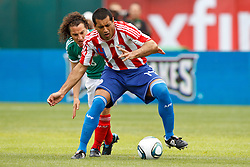 March 26, 2011; Oakland, CA, USA;  Paraguay defender Paulo da Silva (14) is defended by Mexico midfielder Andres Guardado (18) during the first half at Oakland-Alameda County Coliseum.