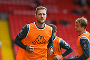Leeds United defender Liam Cooper (6) warming up during the EFL Sky Bet Championship match between Barnsley and Leeds United at Oakwell, Barnsley, England on 15 September 2019.