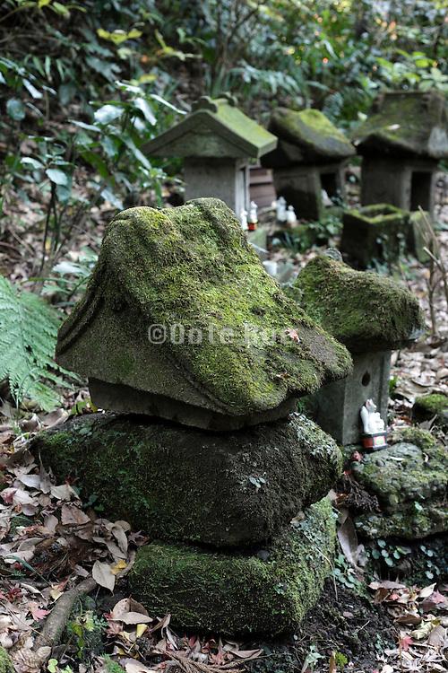 graveyard sculptures at the Sasuke Inari shrine in Kamakura Japan
