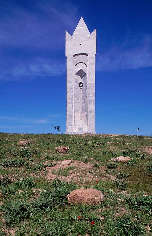 This marble monument in Ordabasy in southern Kazakhstan commemorates the site where elders of the the three Kazakh hordes, Tole Bi,  AytekeBi, and Kazybek Bi united in 1726 to fight the Dqungars (Mongols).  the large pedestal, 28 meters (92 feet) high and eight meters (26 feet ) square, symbolizes the earth, which gave birth to these three sons of the Kazakh people.