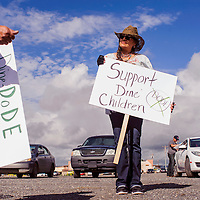 "Norma James carries a sign reading "" Support Diné Children"" during a protest against the Department of Diné Education in Window Rock Thursday. Protesters argued that DODE was mismanaging Navajo Nation Schools and they called for the removal of the superintendent."