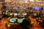 Players gamble at the Grand Lisboa casino in Macau, China, on February 23, 2008. Macao has overtaken Las Vegas with a gambling revenue of 7 billion U.S. dollars in 2006 (Las Vegas' was 6.6 billion U.S. dollars), and is now the world's top casino hut. Photo by Lucas Schifres/Pictobank