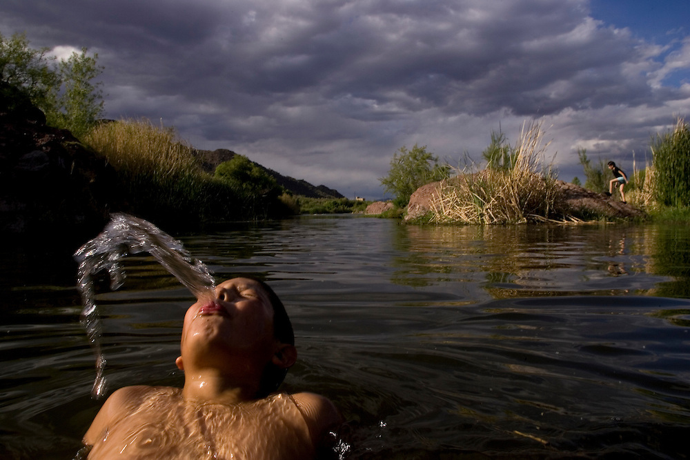 Samuel Adams Jr. enjoys a late afternoon swim in the Verde River. It was the first time he had ever been camping with his dad.