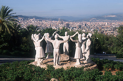 Statue to La Sardana; Barcelona; with view of the city in the background,