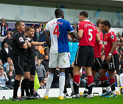 14.05.2011, Ewood Park, Blackburn, ENG, PL, Blackburn Rovers vs Manchester United, im Bild Please be patient, I will hand you the title in just a moment with another dodgy penalty decision... referee Phil Dowd acts up to the television cameras as he gifts Manchester United the penalty to seal their Premier League title during the Premiership match against Blackburn Rovers at Ewood Park, EXPA Pictures © 2011, PhotoCredit: EXPA/ Propaganda/ D. Rawcliffe *** ATTENTION *** UK OUT!