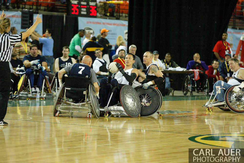 July 7th, 2006: Anchorage, AK - The Blue team and White team reacts to a jump ball as White defeated Blue in the gold medal game of Quad Rugby at the 26th National Veterans Wheelchair Games.