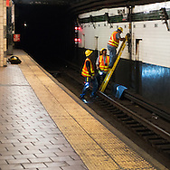 Technicians who keeps the trains running, at work in the 125th street subway station.