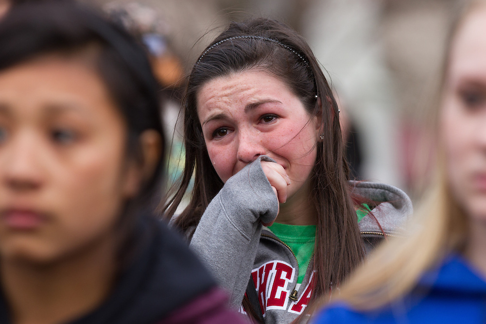 An unidentified woman cries during a vigil for the victim's of Monday's terrorist bombings near the finish line of the Boston Marathon, on Boston Common in Boston, MA on Tuesday, April 16, 2013.  (Matthew Cavanaugh for The Washington Post)