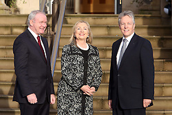 US Secretary of State Hillary Clinton is greeted by the Northern Ireland First Minister Peter Robinson (right) and the Deputy First Minister Martin McGuinness (left) as she arrives at Stormont Castle, in  Belfast, Northern Ireland, Friday December 7th, 2012  Photo by: i-Images