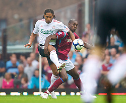 LONDON, ENGLAND - Saturday, September 19, 2009: Liverpool's Glen Johnson and West Ham United's Carlton Cole during the Premiership match at Upton Park. (Pic by David Rawcliffe/Propaganda)
