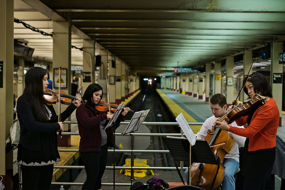 The Hopkins Entertainment Group playing in Grand Central subway station, New York, NY, US