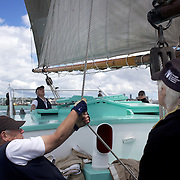 Crewmen in action on the Historic Scow which sails from the NZ Maritime Museum, on Auckland Harbour. Auckland, New Zealand, 3rd November 2010. Photo Tim Clayton