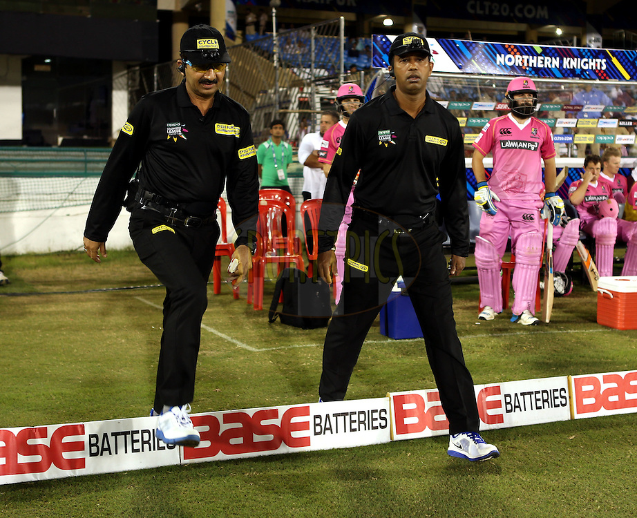 Umpires walks in before the start of the match 3 of the Oppo Champions League Twenty20 between the Cape Cobras and the Northern Knights held at the Chhattisgarh International Cricket Stadium, Raipur, India on the 19th September 2014<br /> <br /> Photo by:  Sandeep Shetty / Sportzpics/ CLT20<br /> <br /> <br /> Image use is subject to the terms and conditions as laid out by the BCCI/ CLT20.  The terms and conditions can be downloaded here:<br /> <br /> http://sportzpics.photoshelter.com/gallery/CLT20-Image-Terms-and-Conditions-2014/G0000IfNJn535VPU/C0000QhhKadWcjYs