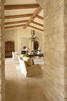 Looking into a living room with furniture and wooden beams