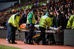 Aston Villa Defender Nathan Baker (ENG) is wheeled down the tunnel on a stretcher with an apparent heads the ball injury during the first half of the match - Photo mandatory by-line: Rogan Thomson/JMP - Tel: Mobile: 07966 386802 - 13/01/2014 - SPORT - FOOTBALL - Villa Park, Birmingham - Aston Villa v Arsenal  - Barclays Premier League.