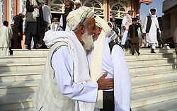 GHAZNI, Sept. 12, 2016 (Xinhua) -- Afghan men embrace each other after Eid al-Adha prayers at a mosque in Ghazni province, eastern Afghanistan, Sept. 12, 2016. Muslims across the world celebrate the Eid al-Adha festival, or the Festival of Sacrifice. (Xinhua/Rahmat Alizadah).****Authorized by ytfs* (Credit Image: © Rahmat Alizadah/Xinhua via ZUMA Wire)