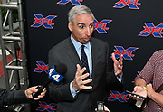 XFL commissioner Oliver Luck is interviewed during a news conference, Tuesday, May 7, 2019, in Los Angeles. Play will begin in the eight-team league on Feb. 8-9, 2020 with teams in Dallas, Houston, Los Angeles, New York, St. Louis, Seattle , Tampa Bay and Washington D.C.