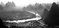 A misty early morning view across Yangshuo and the Li River.