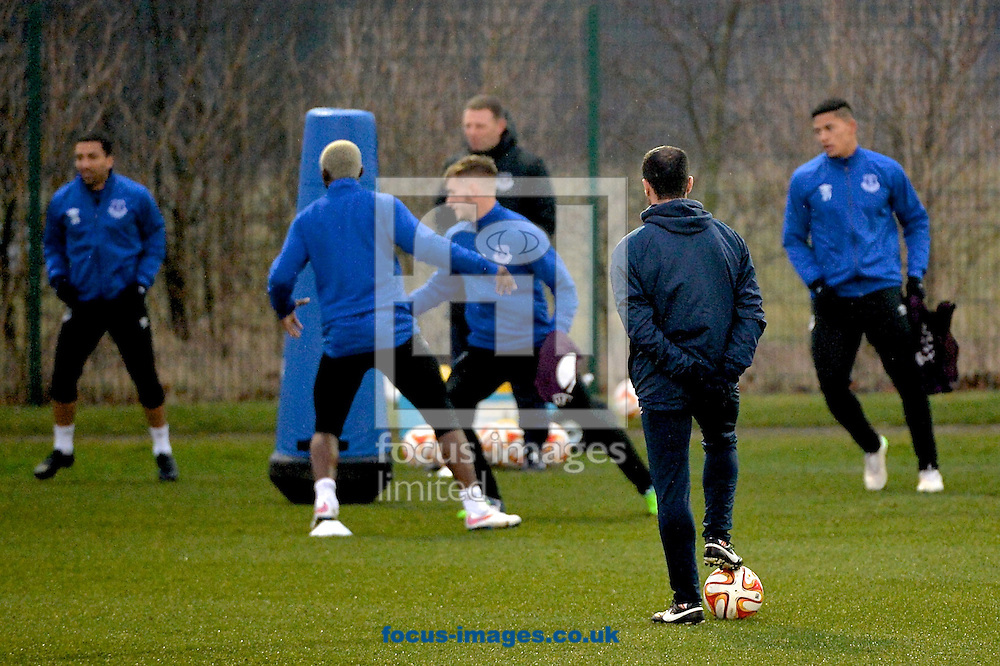 Everton manager Roberto Mart&iacute;nez (2nd right) watches his players during the Everton training session prior to their  Europa League match against Dynamo Kyiv at Finch Farm, Liverpool<br /> Picture by Ian Wadkins/Focus Images Ltd +44 7877 568959<br /> 11/03/2015