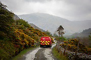 A red post office delivery van driving down Greenside Road, back down the valley to the village of Glenridding on the shore of Lake Ullswater, The Lake District, United Kingdom.  (photo by Andrew Aitchison / In pictures via Getty Images)