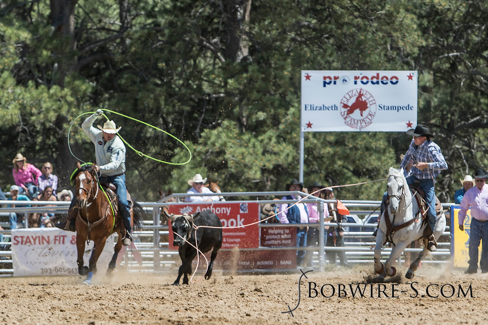 Header Cole Dorenkamp and heeler TJ Watts make their team roping run in the first performance of the Elizabeth Stampede on Saturday, June 2, 2018.